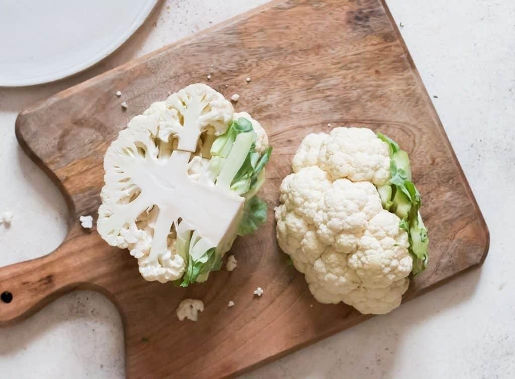 cut cauliflower into half to make cauliflower rice