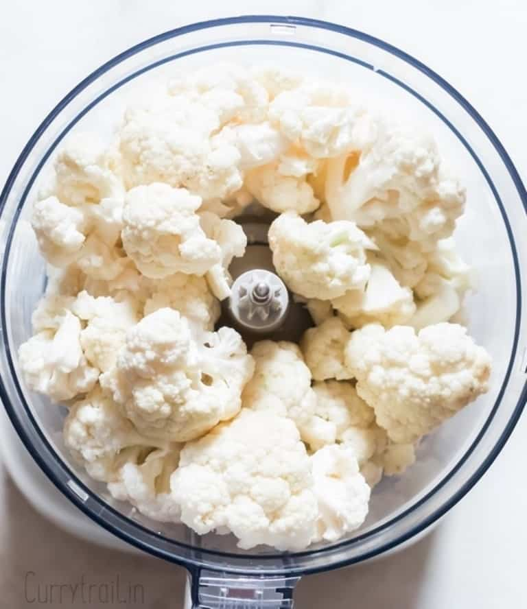 cauliflower florets placed in food processor to make cauliflower rice
