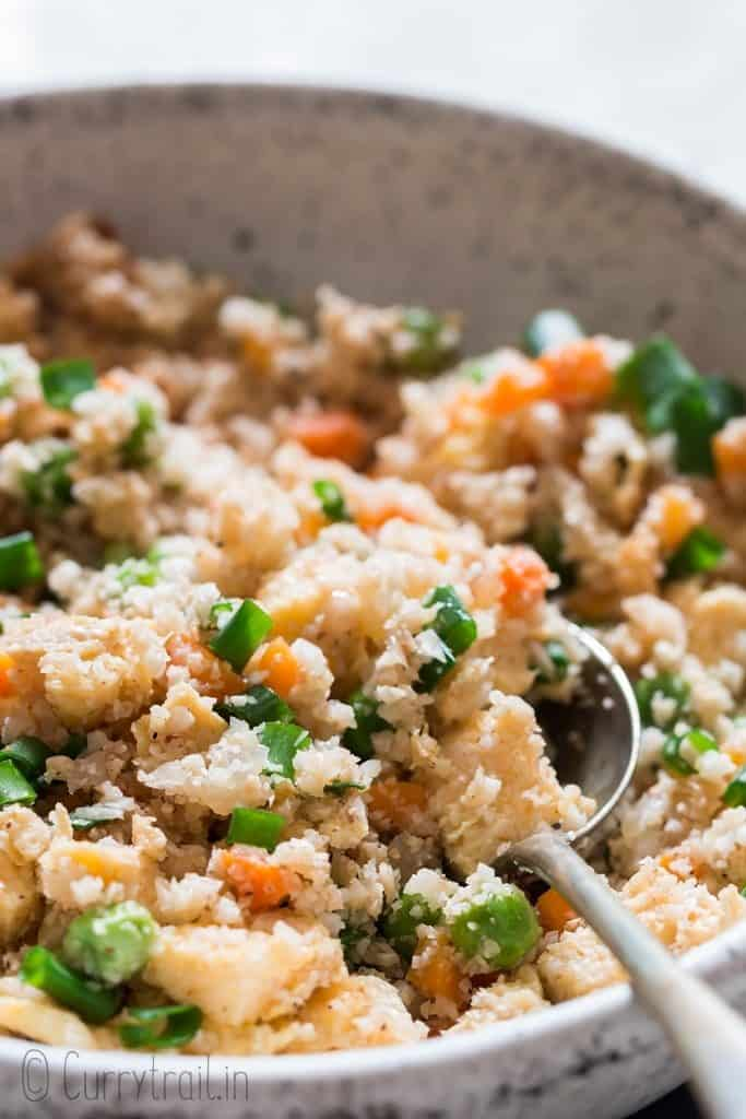 cauliflower fried rice in white bowl