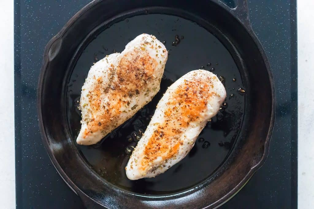 sear chicken breasts on cast iron pan