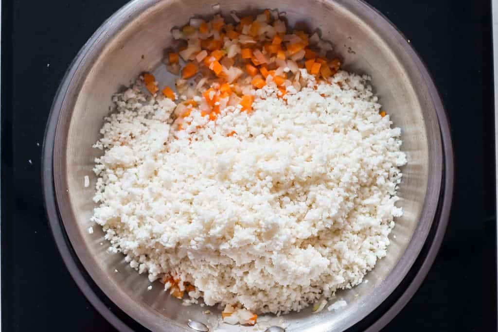 riced cauliflower cooking in a skillet