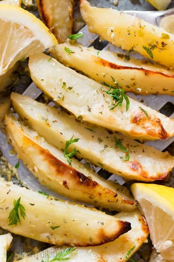 healthy overn roasted Greek lemon potatoes on baking sheet