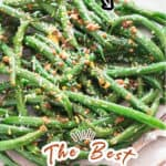 green beans sauteed with lemon garlic Parmesan on white plate with text