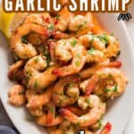 lemon garlic shrimp served in white oval plate with text overlay