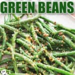 sauteed green beans with lemon garlic and Parmesan cheese on white plate with text overlay