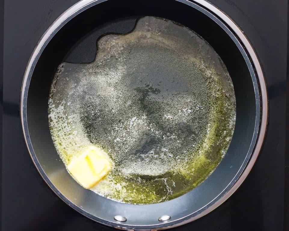 melting butter and olive oil in skillet