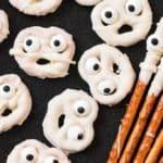 ghost halloween pretzels on black plate