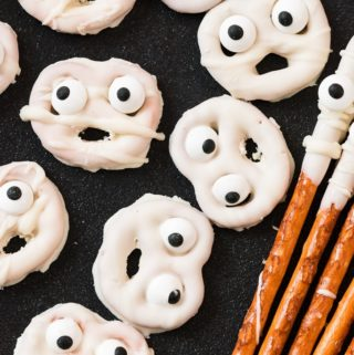 ghost halloween pretzels on black plate