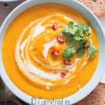 Thai vegan pumpkin curry soup with crusty bread on side