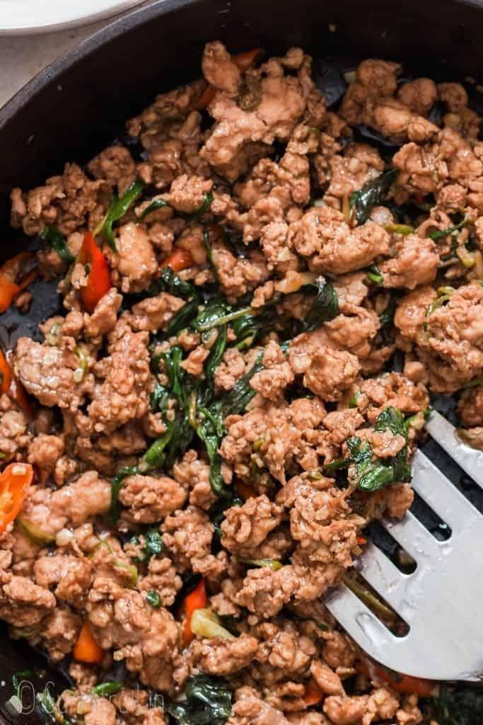 spicy thai basil chicken in pan