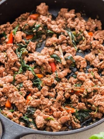 spicy Thai basil chicken in cast iron pan