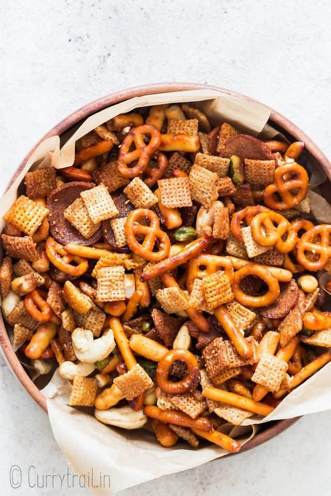 sweet and spicy chex mix in wooden bowl