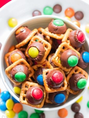pretzel chocolate with M&M candies in white bowl