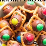 waffle pretzels with kisses and m&m in bowl with text