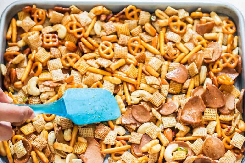 homemade chex mix ingredients spread on baking tray