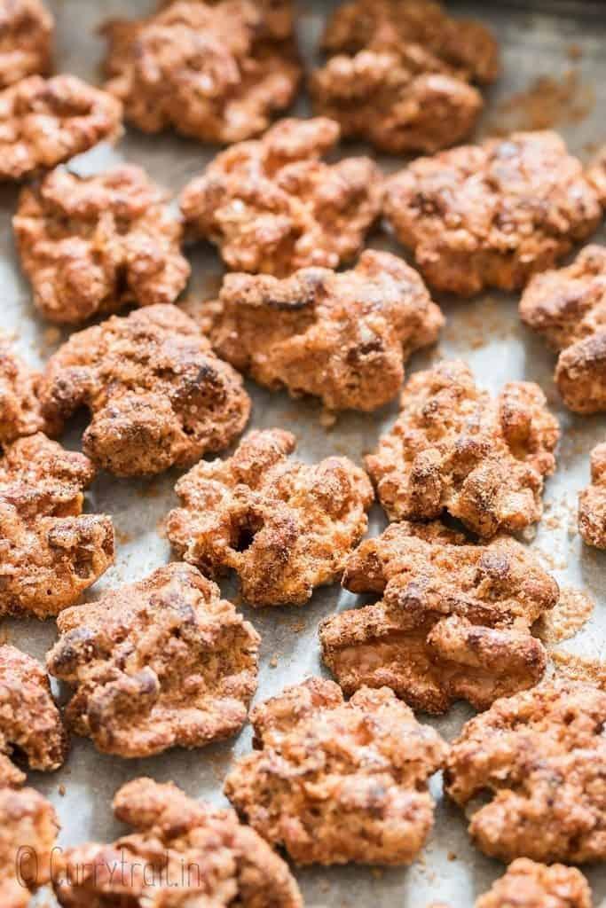 candy walnuts arranged on baking tray