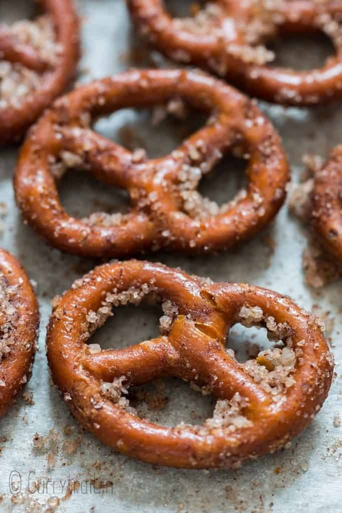 baked cinnamon coated pretzels on baking tray