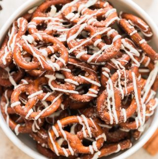 cinnamon sugar coated pretzels with white chocolate drizzle