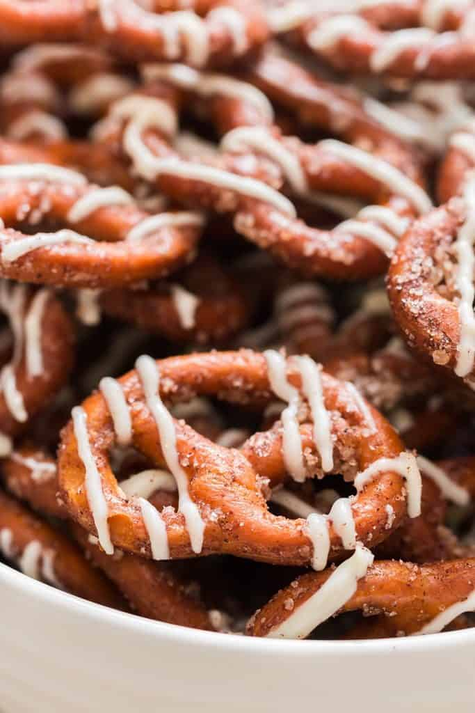 close view of cinnamon sugar coated pretzels with white chocolate drizzle