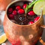 Cranberry Moscow Mule in copper cups with text overlay