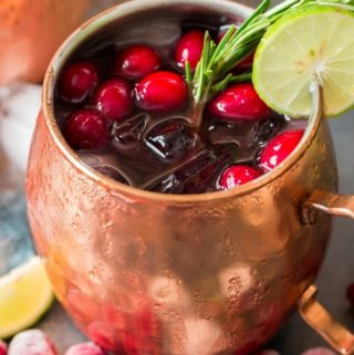 cranberry Moscow mule served in copper cups with ice, cranberries and lime