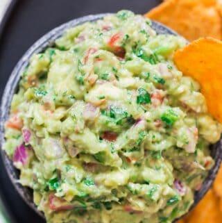 homemade guacamole dip served wiht nachos