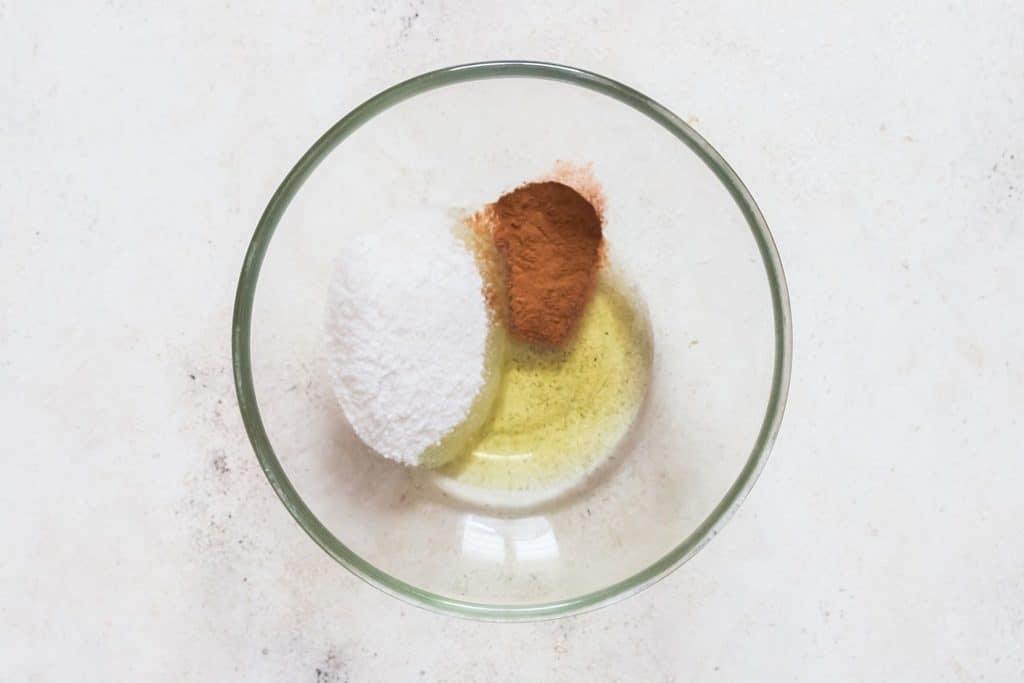 mixing oil cinnamon powder and sugar in bowl