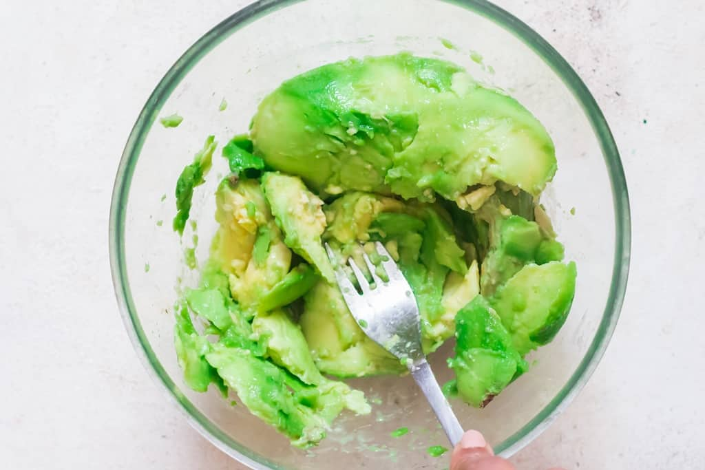 mash avocado with fork