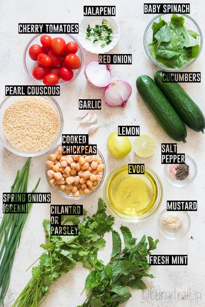 ingredients for Israeli couscous salad spread on a board