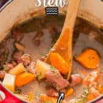 lamb stew cooked in dutch oven with text