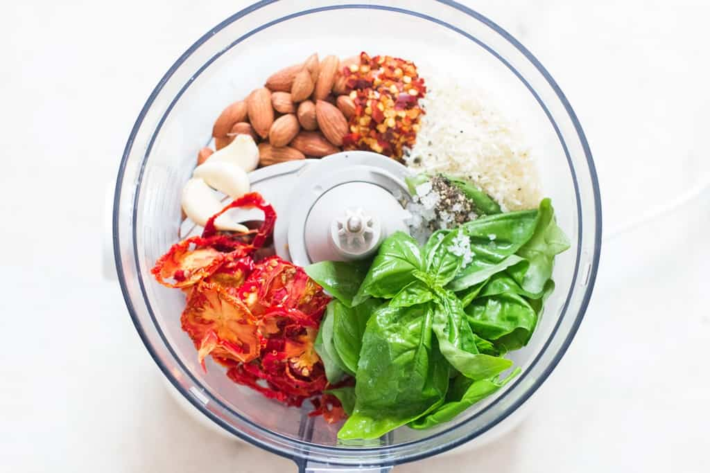 all ingredients for sun dried tomato pesto in food processor