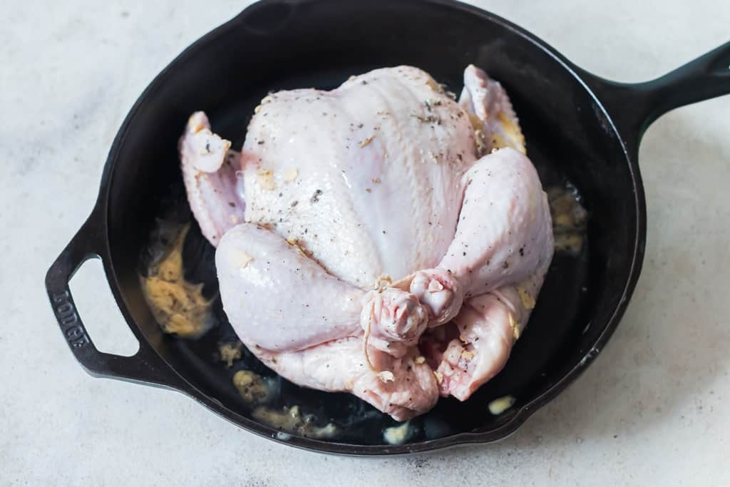 whole chicken before roasting in cast iron pan