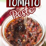 sun dried tomato pesto in glass jar with text