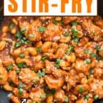 stir fried cashew chicken in wok with text overlay