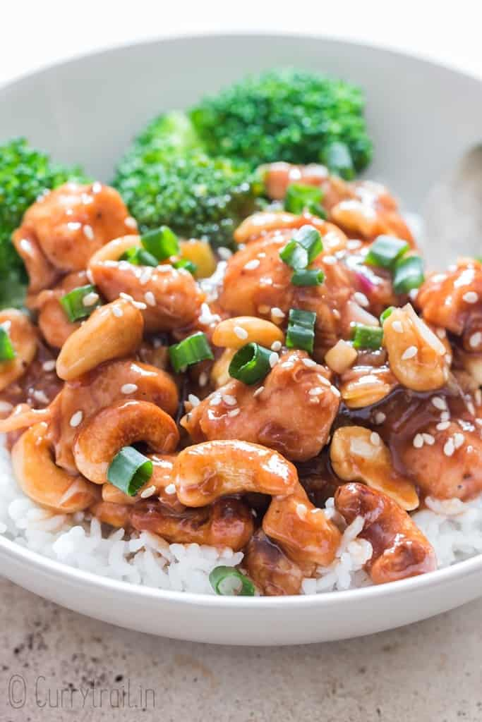 cashew chicken stir fry served over rice and broccoli in a bowl