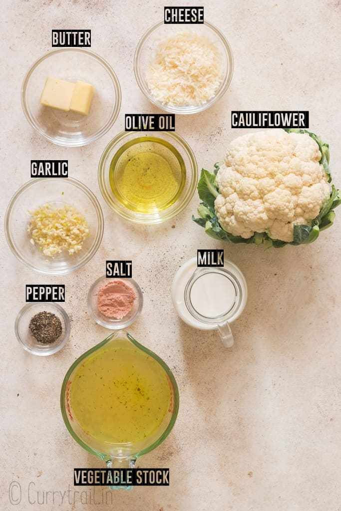 all ingredients for cauliflower cheese sauce on white board