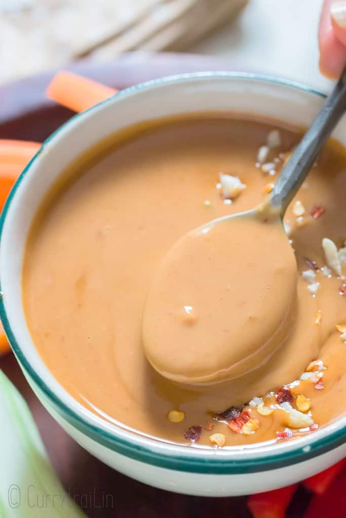 peanut sauce in a bowl with spoon
