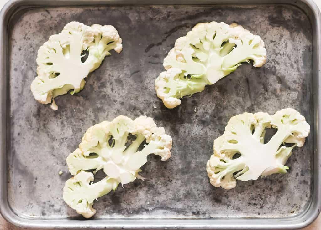 arrange cauliflower steaks on baking tray