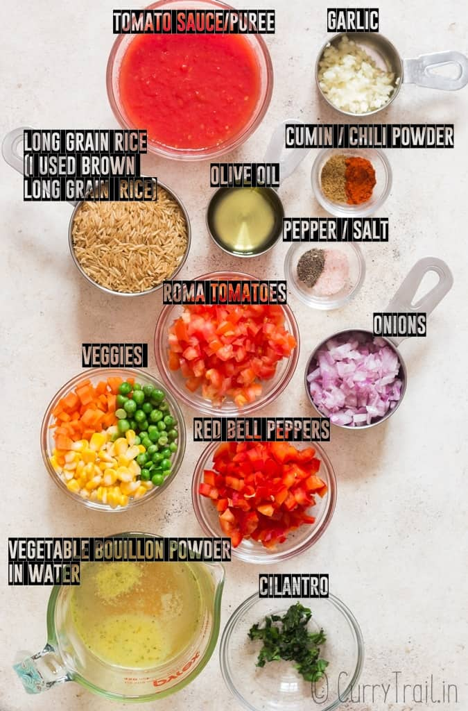 ingredients for instant pot mexican rice arranged on a board