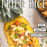 pineapple fried rice served in pineapple bowl with text overlay