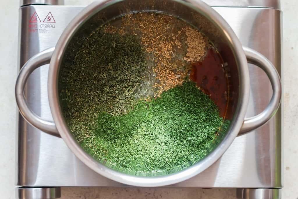 rice and seasoning in saucepan