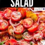 fresh tomato salad served in wooden salad bowl with text