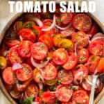 summer cherry tomato salad served in wooden salad bowl with text overlay