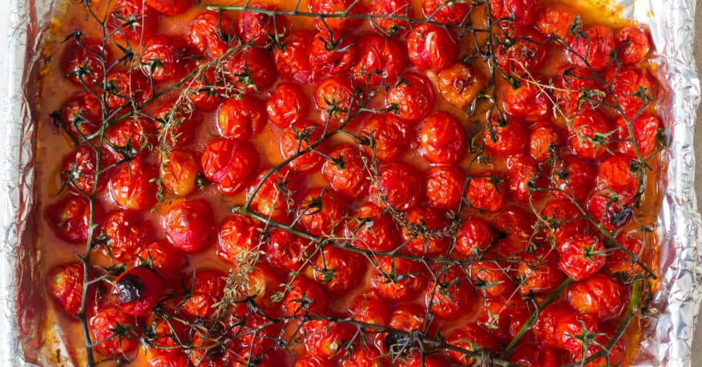 Roasted cherry tomatoes in baking tray