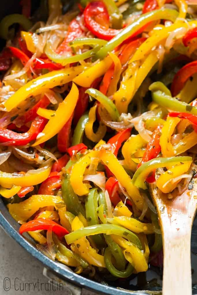 sauteed peppers and onions in a skillet