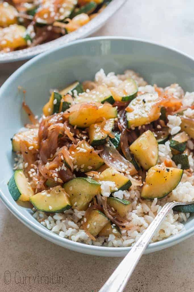 healthy Asian zucchini stir fry served over rice