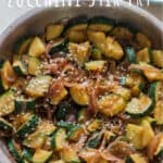 healthy Asian zucchini stir fry served over rice with text