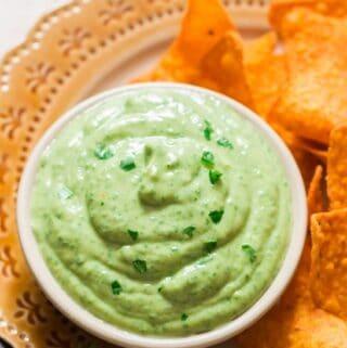 creamy avocado dip served with nachos