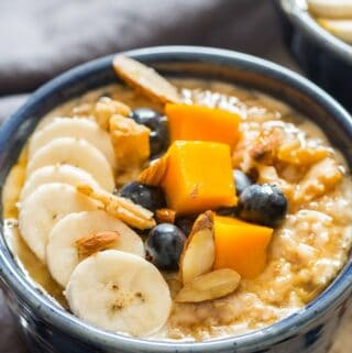 instant pot steel cut oats served with fruits and berries in ceramic bowls