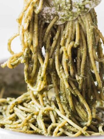 chicken pesto pasta cooked in skillet